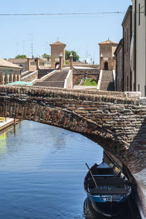 Comacchio (Ferrara, Emilia Romagna, Italy) - Bridges over a canal with boats Stock Photo - 17288705