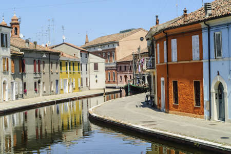 Comacchio (Ferrara, Emilia Romagna, Italy) - Winding canal with boat and colorful houses Stock Photo - 17269850