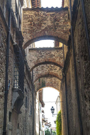 Sansepolcro (Arezzo, Tuscany, Italy) - Old typical street with arches Stock Photo - 17328174