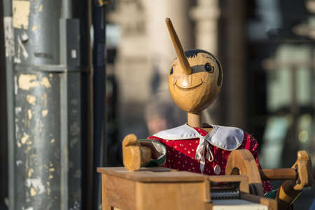 Milan (Lombardy, Italy), wooden music box with Pinocchio Stock Photo