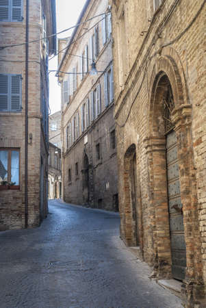 Fermo (Marches, Italy) - Typical street with old buildings photo