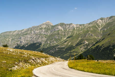 The road of Campo Imperatore (LAquila, Abruzzi, Italy) in the Gran Sasso dItalia natural park. photo