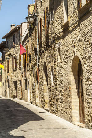 bevagna: Bevagna (Perugia, Umbria, Italy) - Old typical alley with flags