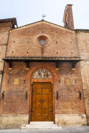 Siena (Tuscany, Italy) - Ancient church, facade with lunette photo
