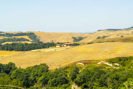 Crete senesi, characteristic landscape in Val d'Orcia (Siena, Tuscany, Italy) along the road from Asciano to Torre a Castello. Farm. Stock Photo - 19160030