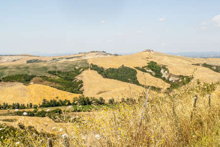 Crete senesi, characteristic landscape in Val d'Orcia (Siena, Tuscany, Italy) along the road from Asciano to Torre a Castello Stock Photo - 19160032