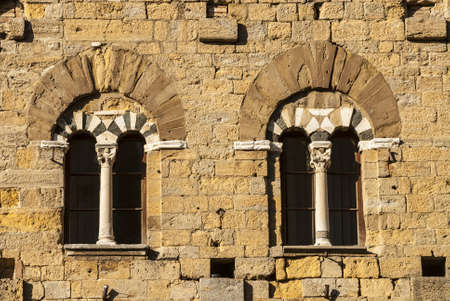 Volterra (Pisa, Tuscany, Italy) - Two mullioned windows of a medieval palace photo