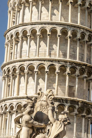 putto: Pisa (Tuscany) - The bending tower and a statue with putto