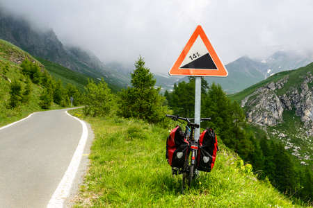 bycicle: Road to Colle dellAgnello (Cuneo, Val Varaita, Piedmont, Italy), in the western Alps, at summer, with bycicle