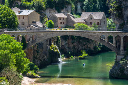 Gorges du Tarn (Lozere, Linguedoc-Roussillon, France), famous canyon at summer. Village, bridge and canoes Stock Photo