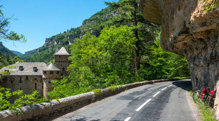 gorges: Gorges du Tarn (Lozere, Linguedoc-Roussillon, France), famous canyon at summer: historic castle and bicycle Stock Photo