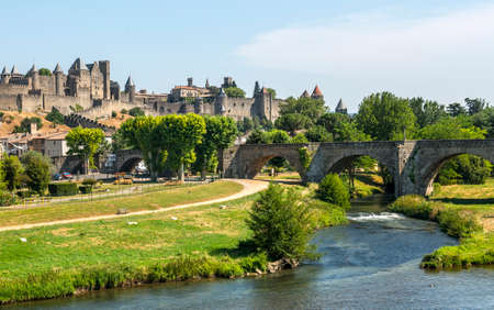 Carcassonne (Aude, Languedoc-Roussillon, France) - The Cite, the bridge and the river in a summer afternoon Stock Photo