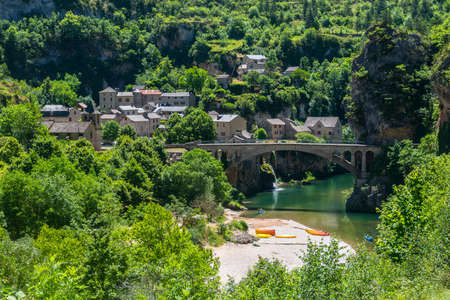 gorges: Gorges du Tarn (Lozere, Linguedoc-Roussillon, France), famous canyon at summer. Village, bridge and canoes Stock Photo