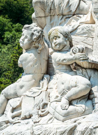 putto: Nimes (Gard, Languedoc-Roussillon, France), statues and fountain in the park