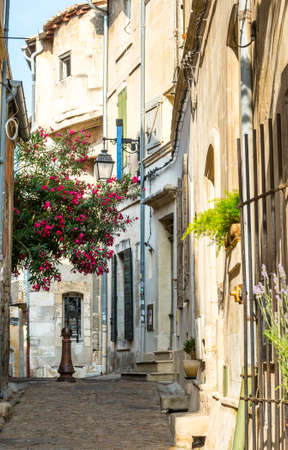arles: Arles (Bouches-du-Rhone, Provence-Alpes-Cote dAzur, France) - Old typical street near the Roman Arena Stock Photo