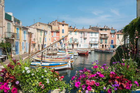 Martigues (Bouches-du-Rhone, Provence-Alpes-Cote dAzur, France): the old harbor with boats and flowers