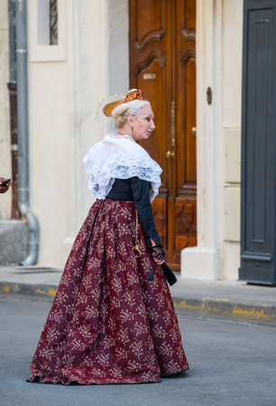 arles: Arles (Bouches-du-Rhone, Provence-Alpes-Cote dAzur, France) - Woman  dressed with traditional costume