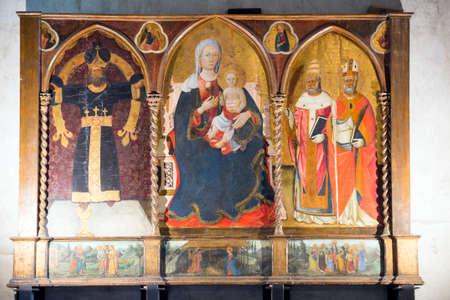 triptych: Codiponte (Massa e Carrara, Tuscany, Italy), old village in Lunigiana: the medieval church of Saints Cornelio and Cipriano, built in 12th century, interior. Triptych.