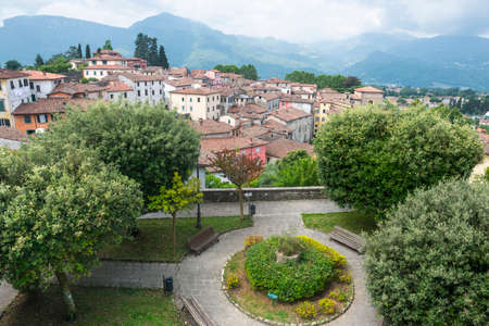 Barga (Lucca, Tuscany, Italy): buildings and garden in the historic town in Garfagnana