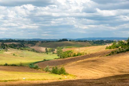 характеристика: Crete senesi, characteristic landscape in Val dOrcia (Siena, Tuscany, Italy) at summer.