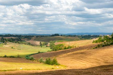 characteristic: Crete senesi, characteristic landscape in Val dOrcia (Siena, Tuscany, Italy) at summer.