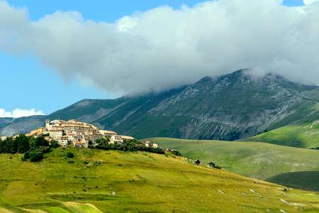 monti: Piano Grande di Castelluccio (Perugia, Umbria, Italy), famous plateau in the natural park of Monti Sibillini. The old village