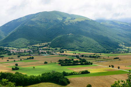 View on the plain of Norcia from the road to Forca Canapine (Perugia, Umbria, Italy), in the park of Monti Sibillini, at summer photo
