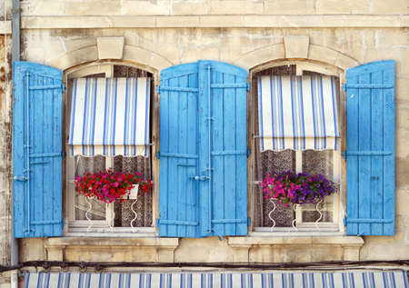 les: Arles (Provence, France) - Two windows of a house in front of Les Arenes Stock Photo