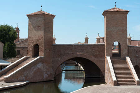 comacchio: Comacchio (Ferrara, Emilia-Romagna, Italy): the typical city with its canals. The famous bridge named Trepponti