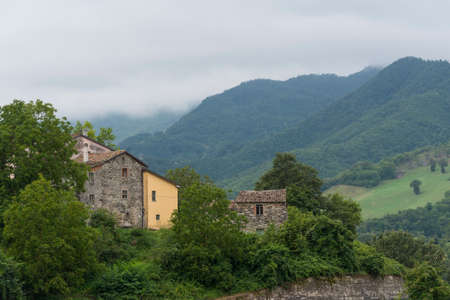 Mountain landscape in Montefeltro (Marches, Italy) at summer. Old village