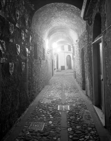 massa: Aulla (Massa e Carrara, Tuscany, Italy), historic town in Lunigiana. Covered alley at evening
