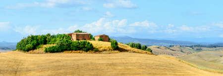 characteristic: Crete senesi, characteristic landscape in Val dOrcia (Siena, Tuscany, Italy), at summer. Typical farm