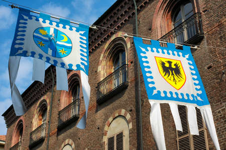 palio: Asti (Piedmont, Italy): historic street with flags for the medieval Palio Stock Photo