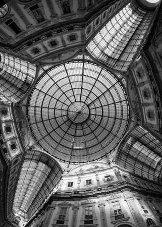 vittorio emanuele: Milan (Lombardy, Italy): the Gallery Vittorio Emanuele II, a covered public place built in 1865-1877. Black and white Editorial