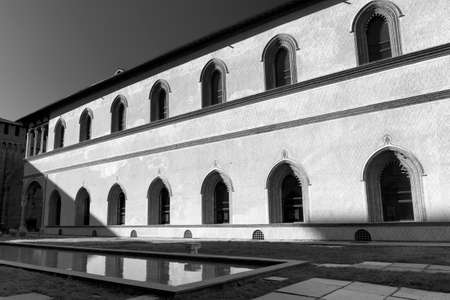 sforzesco: Milan (Lombardy, Italy): internal court of the medieval castle known as Castello Sforzesco (built at end of 15th century). Black and white Editorial
