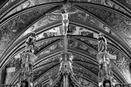 wood pillars: Albi (Tarn, Midi-Pyrenees, France) - Interior of the historic cathedral, in gothic style. Crucifixion. Black and white