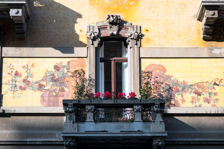 balcony window: Window and balcony with plants and flowers in Milan (Lombardy, Italy) in Liberty style Stock Photo