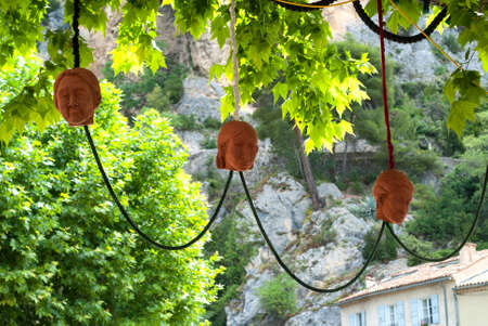 dazur: Moustiers-Ste-Marie (Alpes-de-Haute-Provence, Provence-Alpes-Cote dAzur, France) - Hanged masks Stock Photo