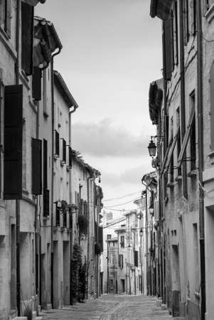 roussillon: Uzes (Languedoc- Roussillon, France) - Historic typical street. Black and white