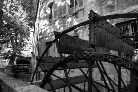 watermills: Avignon (Provence-Alpes-Cote dAzur, France): rue des teinturiers and its watermills. Black and white