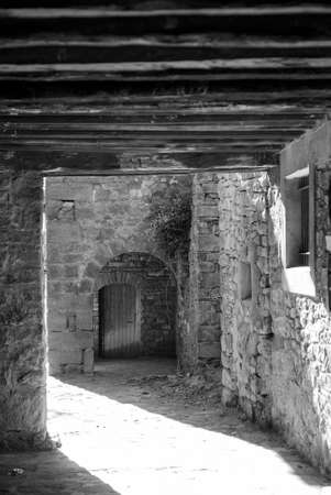 portico: Vilamur (Catalunya, Spain): old typical village in the Pyrenees: portico. Black and white Stock Photo