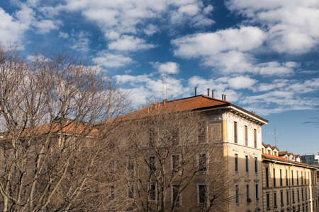 restored: Milan (Lombardy, Italy): old typical restored residential building and trees at winter