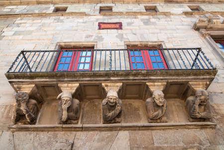 catalunya: Cervera (Catalunya, Spain): historic palace with grotesque statues