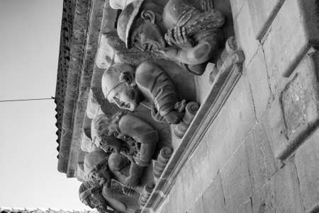 catalunya: Cervera (Catalunya, Spain): historic palace with grotesque statues. Black and white Editorial