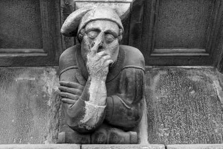 grotesque: Cervera (Catalunya, Spain): historic palace with grotesque statues. Black and white Stock Photo