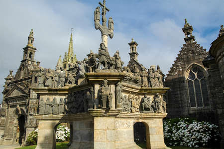 calvary: Guimiliau (Finistere, Brittany, France): the medieval church with the typical stone calvary