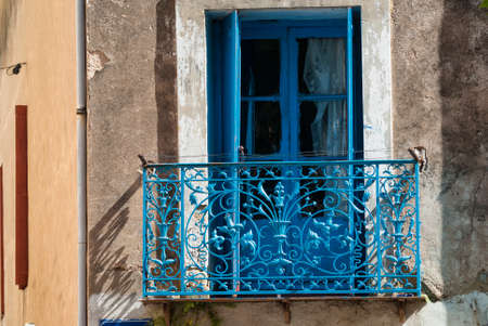 balcony window: Montagnac (Languedoc-Roussillon, France):  blue window and balcony