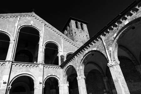 portico: Milan (Lombardy, Italy): the medieval church of SantAmbrogio, in Romanesque style. Facade and portico. Black and white Stock Photo