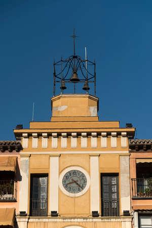 mancha: Toledo (Castilla-La Mancha, Spain): facade of historic palace in the Zocodover square, with clock and bells