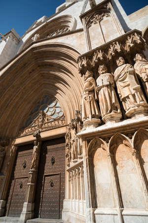 catalunya: Tarragona (Catalunya, Spain): exterior of the gothic cathedral, detail of facade, the door Stock Photo